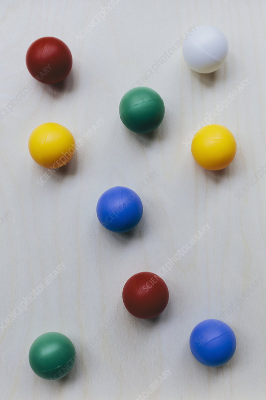 Multicoloured balls arranged on wood background