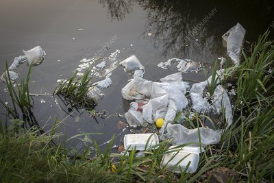 Plastic garbage in waterway