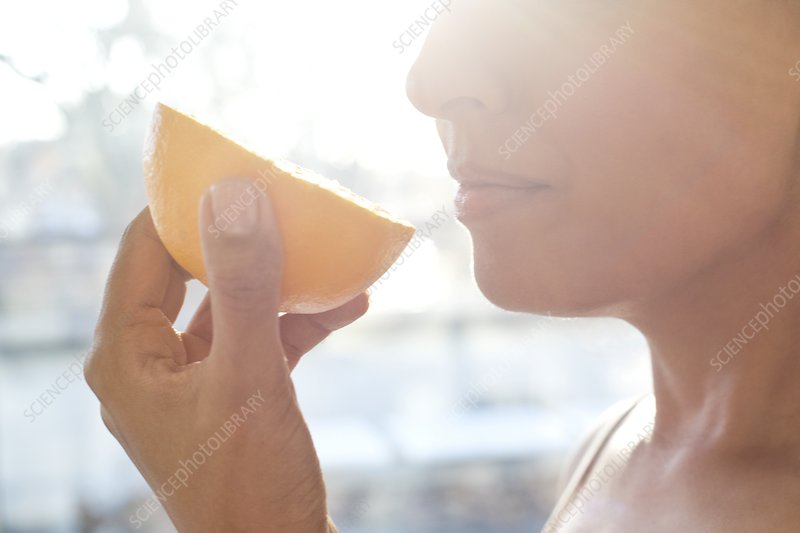 Woman holding half an orange