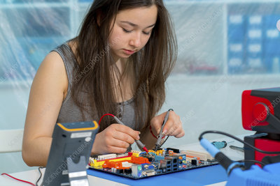 Girl working on electronics project