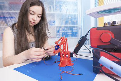 Girl working on robotics project