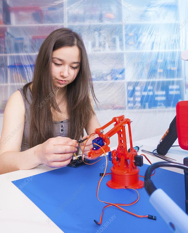 Girl working on robotics project