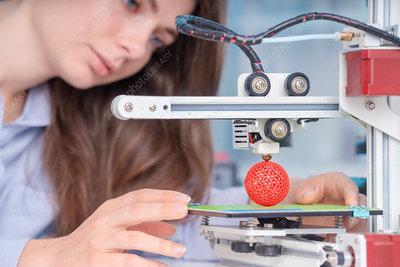 Technician using 3D printer
