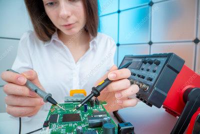 Engineer working on circuit board