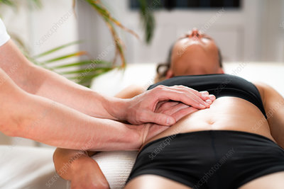Chiropractor working with female athlete