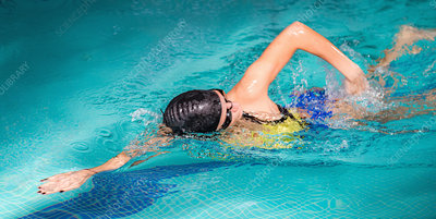 Woman swimming front crawl
