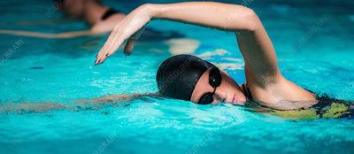 Women in indoor swimming pool