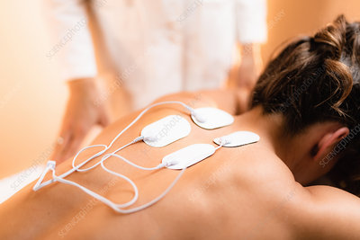 Physical therapy with TENS machine