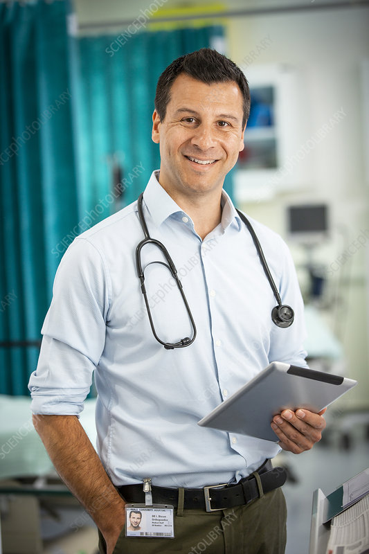Portrait male doctor with digital tablet in hospital