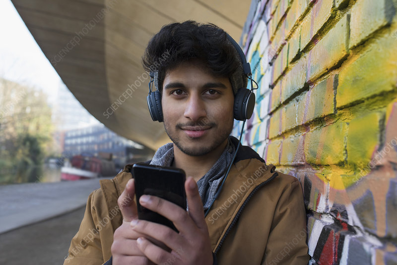 Man listening to music with headphones and mp3 player