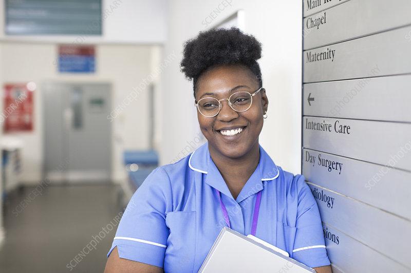 Portrait female nurse in hospital corridor