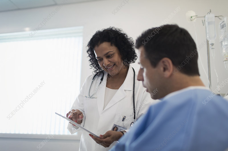 Doctor with tablet making rounds