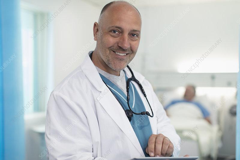 Portrait confident, doctor using tablet in hospital room