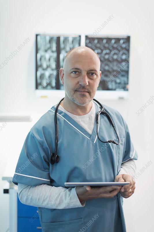 Portrait male doctor using digital tablet in hospital