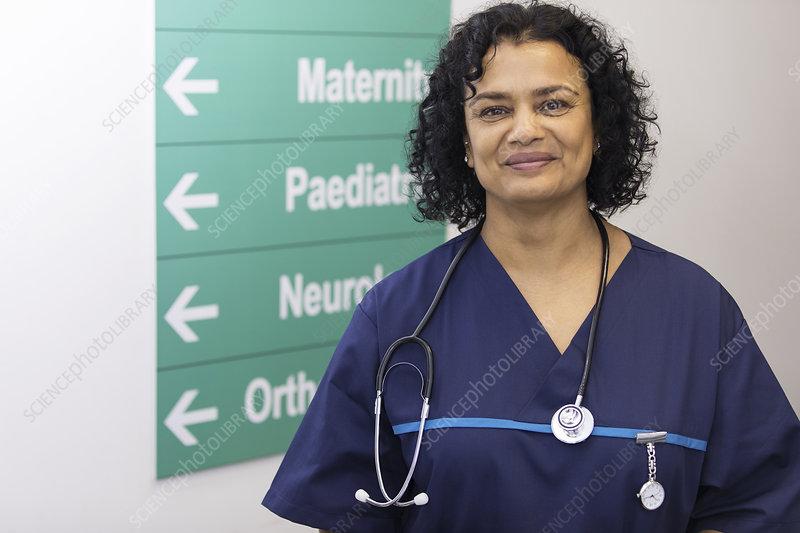 Portrait female doctor in hospital corridor