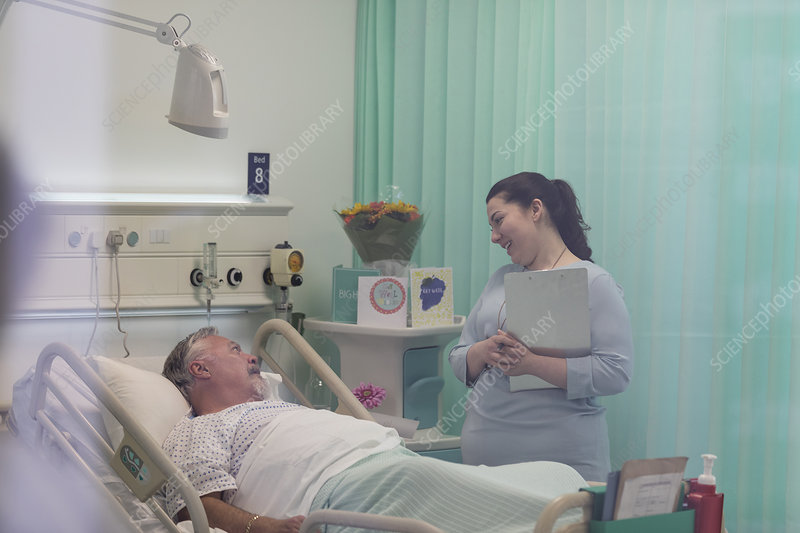 Doctor with medical chart talking with patient