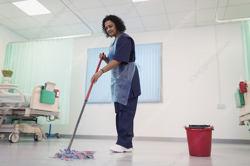 Female orderly mopping hospital ward floor