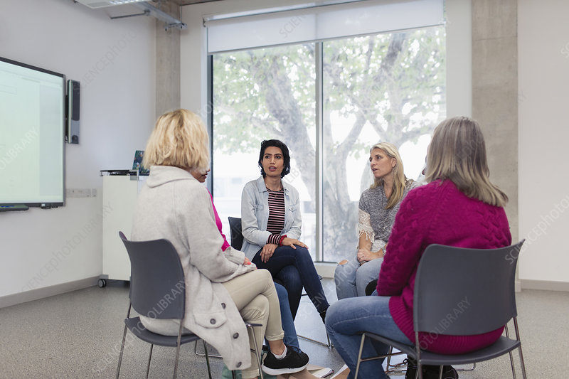 Women's support group meeting in circle