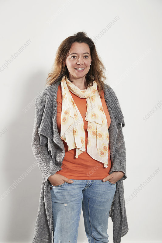Portrait woman wearing scarf sweater and jeans