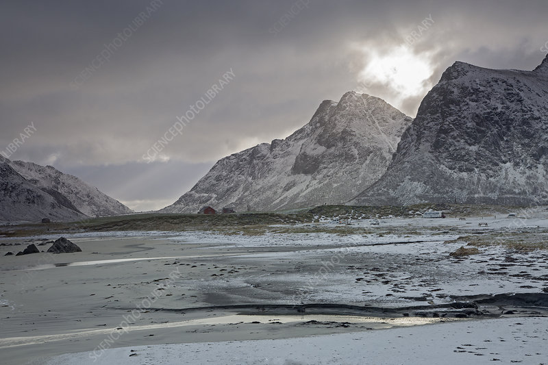 Tranquil snow covered mountains Skagsanden Lofoten Norway