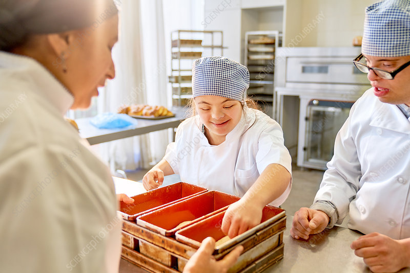 Chef and students with Down Syndrome baking bread