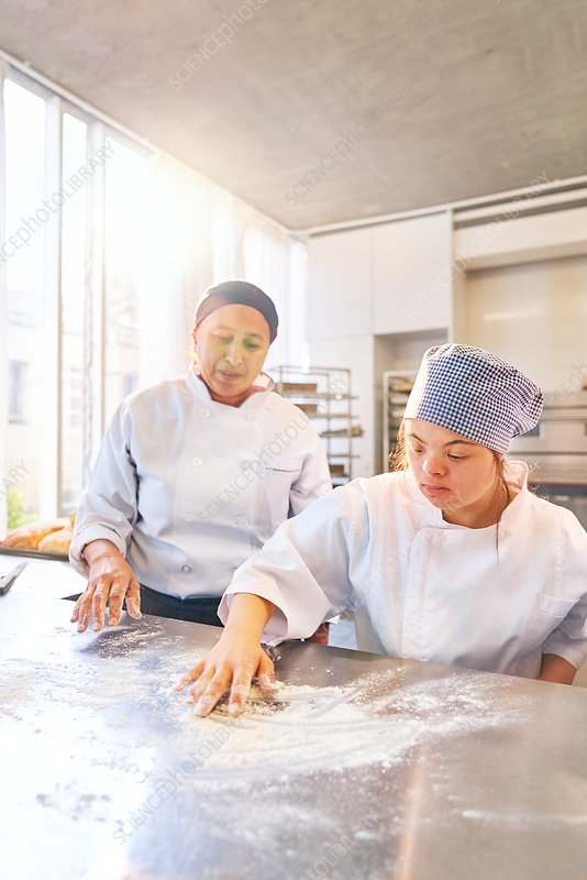 Baking instructor and student with Down Syndrome