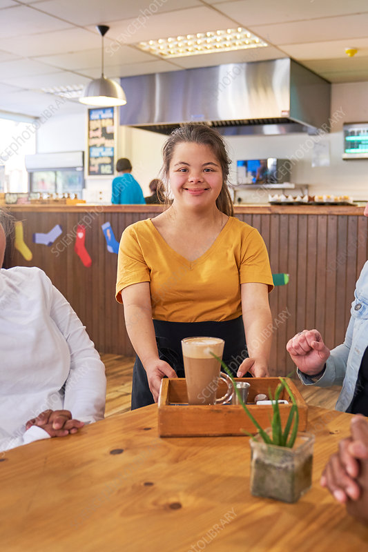 Server with Down Syndrome working in cafe