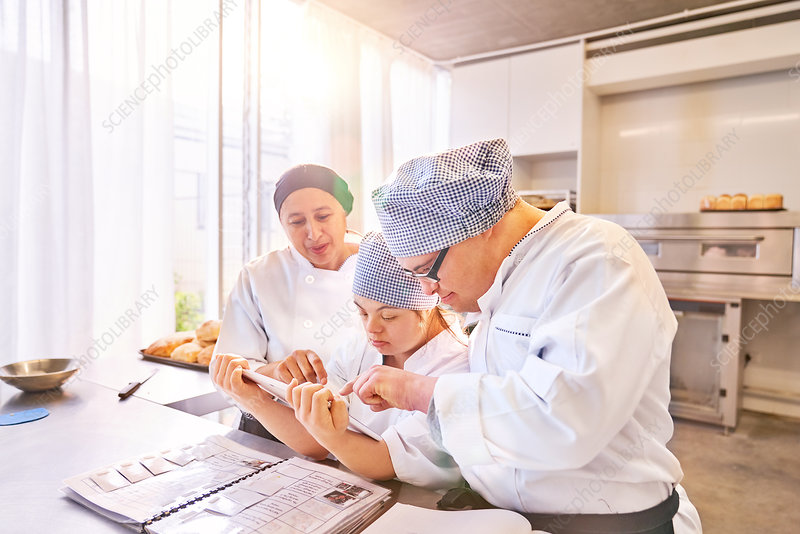 Chef and students with Down Syndrome using tablet