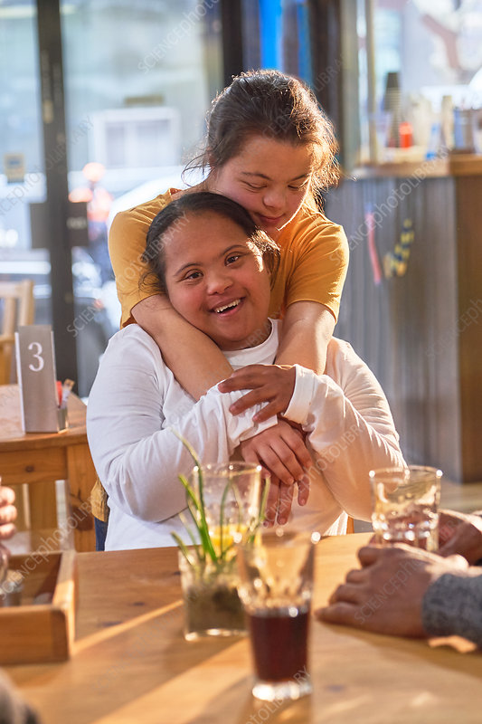 Portrait happy young women with Down Syndrome in cafe