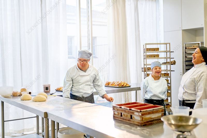 Chef and students with Down Syndrome baking in kitchen