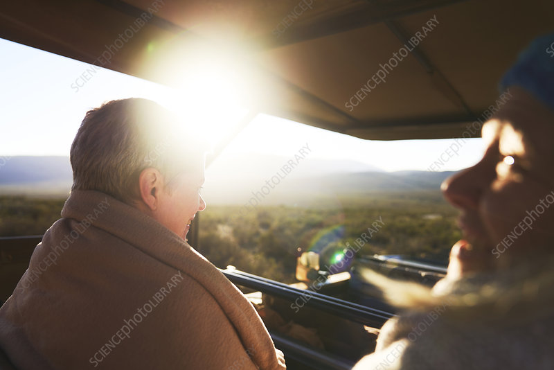 Happy senior women riding in safari off-road vehicle
