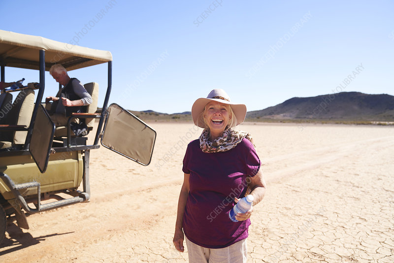 Carefree woman on safari in sunny desert South Africa
