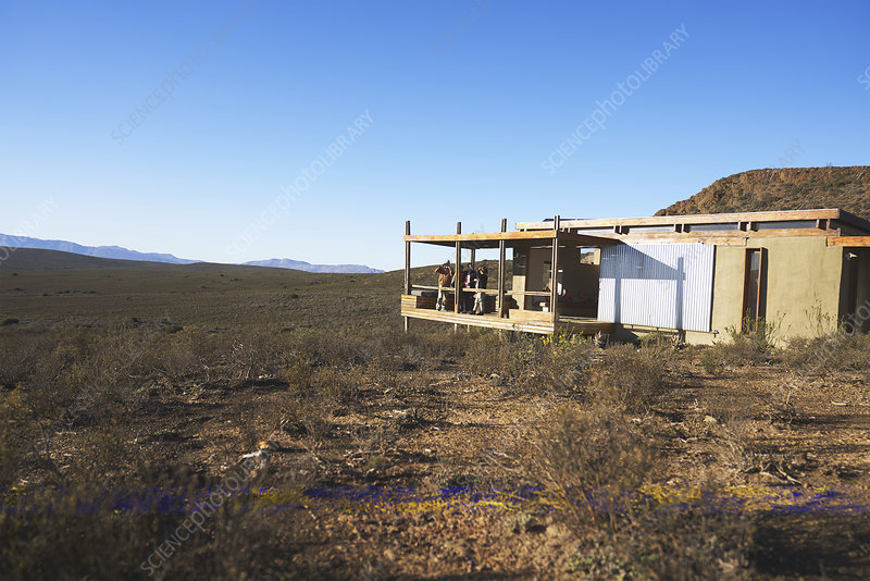 Friends on sunny balcony of safari cabin South Africa