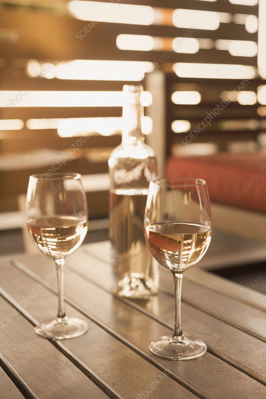 Rose wine on wooden patio table