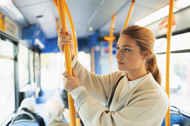 Woman riding bus