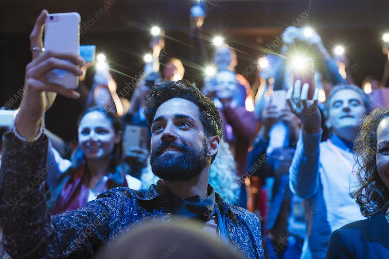 Audience using smart phone flashlights