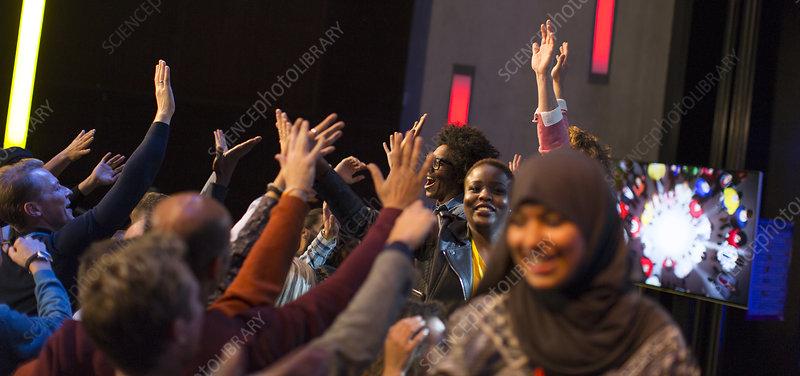 Audience cheering for female speakers