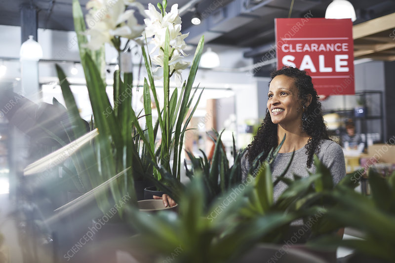 Smiling woman shopping for home decor