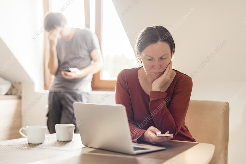 Stressed couple working from home
