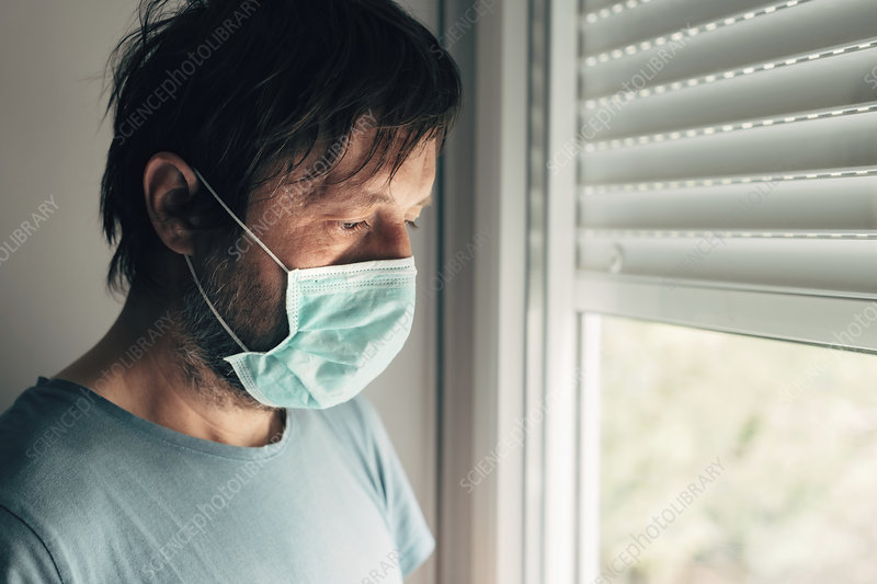 Depressed man with protective mask in quarantine