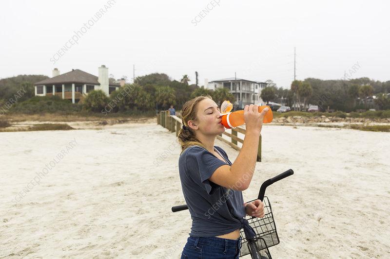 Teenage girl drinking water, St Simon's Island Georgia