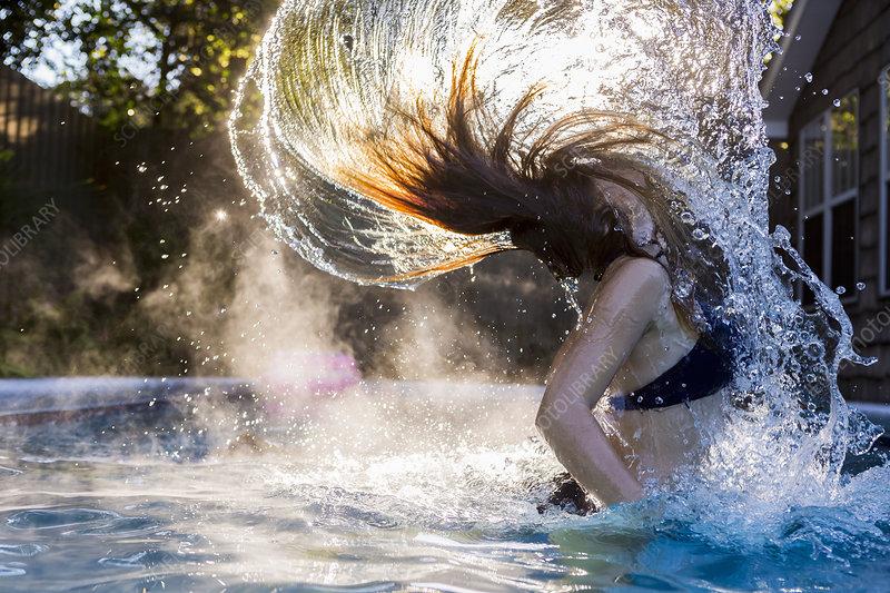 13 year old girl swimming in a pool