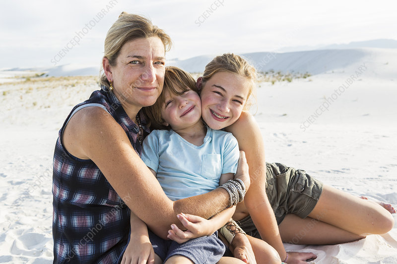Portrait of mother and her children in sand dunes