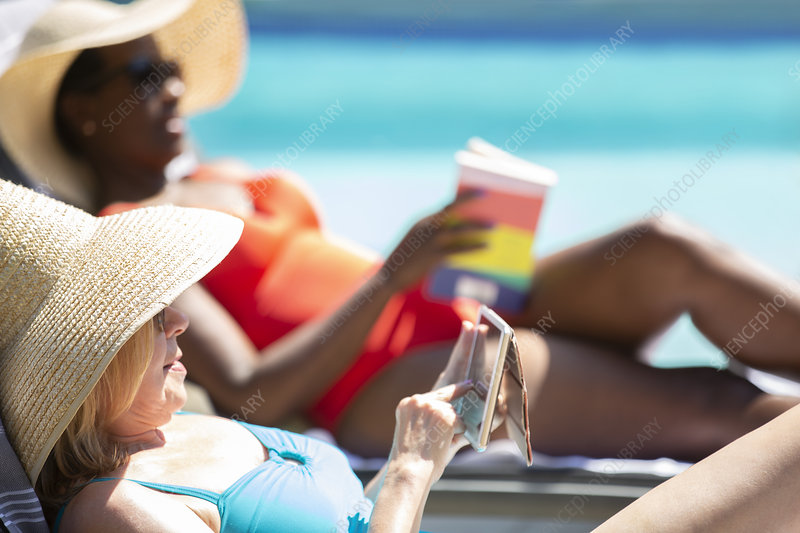 Senior woman using smart phone and sunbathing