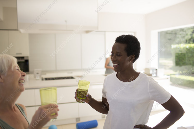 Senior women friends after exercising at home