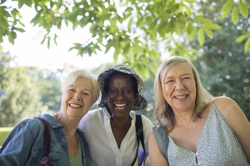 Portrait beautiful senior women friends in summer park