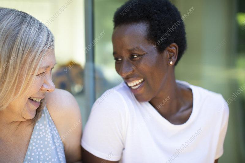 Happy senior women friends laughing