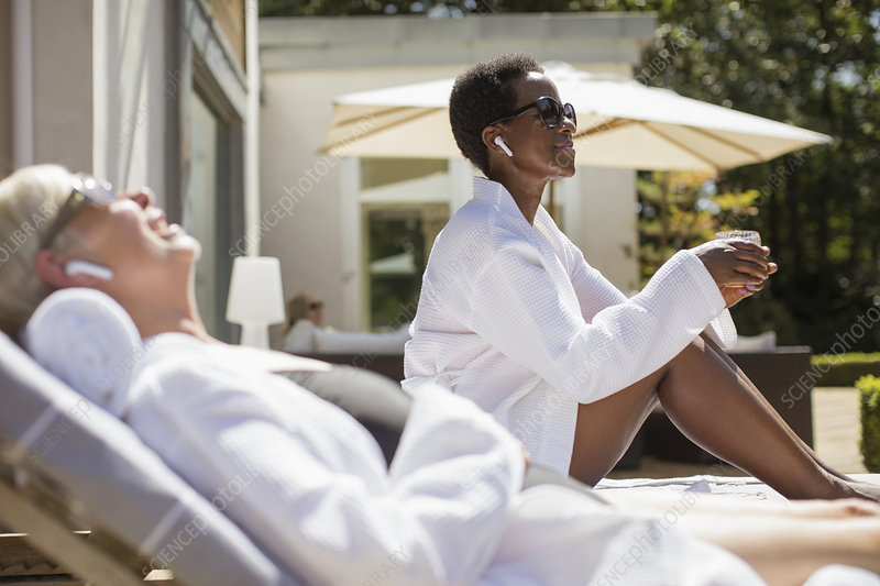 Senior women in spa robes relaxing on hotel patio