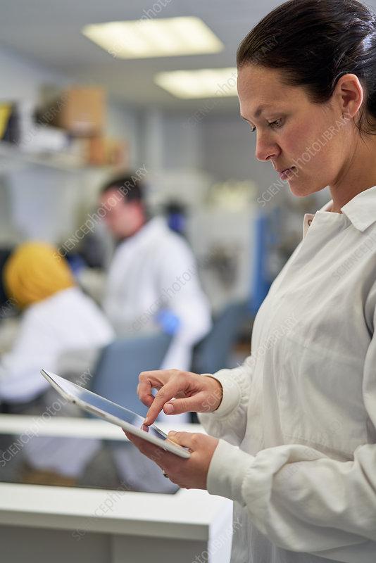 Female scientist using digital tablet in laboratory