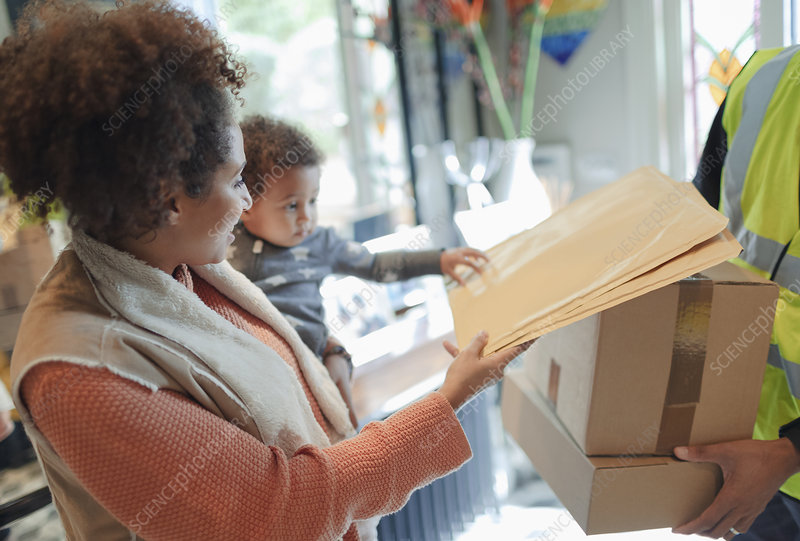 Mother and baby daughter receiving package